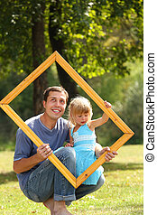 father with  daughter in a frame