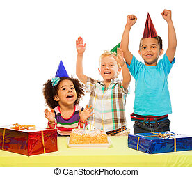 Birthday party - Three kids celebrating birthday - two boys...