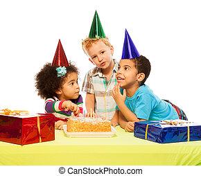 Three kids and birthday cake