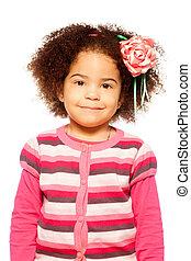 Happy dark skinned girl smiling at camera