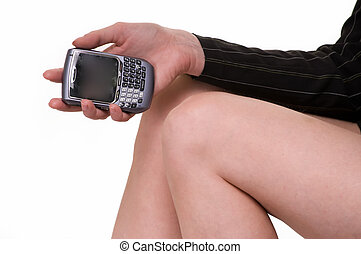 Hand holding a cell phone - Close up of a womans knees and...