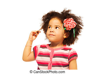 Clever little black girl thinking - portrait on white