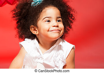 Portrait of little black curly haired girl