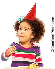 Kid eating birthday cake