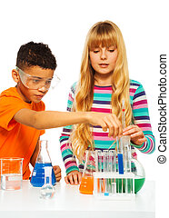 Couple kids in science lab - Two kids, black boy and blond...