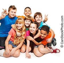 Happy boys and girls - Group of happy smiling kids sitting...