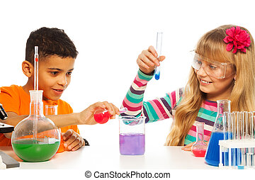 Kids experimenting in chemistry - Kids experimenting with...