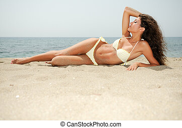 Woman with beautiful body on a tropical beach - Portrait of...