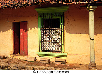 Old door and window in colorful wall - Mexican wall with red...