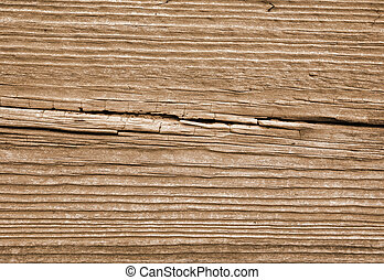 Old weathered brown wood lines close up.