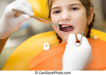 Dental visit - Little girl is having her teeth checked by...