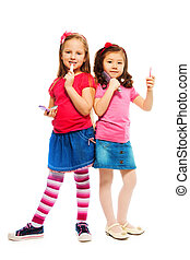 Two little big girls - Two girls Caucasian and Asian playing...