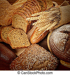 The Bread - fresh bread  and wheat on the wooden