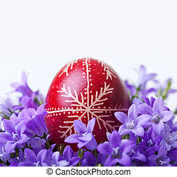 Decorated easter egg with spring flowers