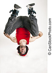 up side down bbou - young man siting on his head isolated...