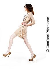 Fashion Model walking In Trendy Brown Dress. Shopping