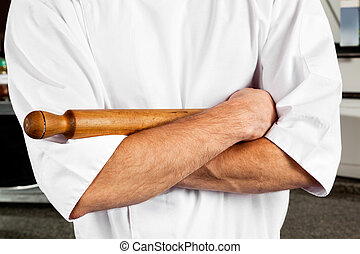 Male Chef With Rolling Pin - Midsection of young male chef...