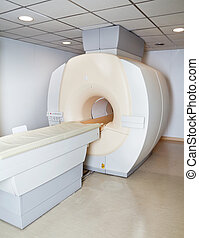 MRI Machine - Emtpy room with MRI machine in hospital