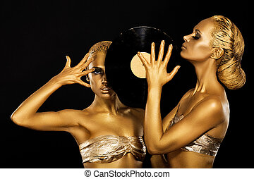 Fetish. Women DJs holding Retro Vinyl Record. Fantastic Gold...