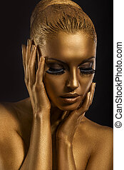 Face Art. Fantastic Gold Make Up. Stylized Colored Woman's...