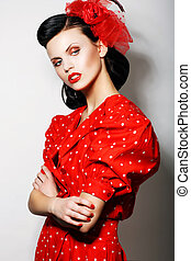 Refinement. Sophisticated Arrogant Woman in Red Polka Dot Dress with Crossed Arms. Fashion. Retro Style - Pin Up
