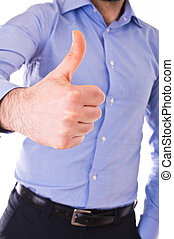 Young business man giving a thumbs up.