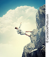 businesswoman climbing mountain - businesswoman climbing...