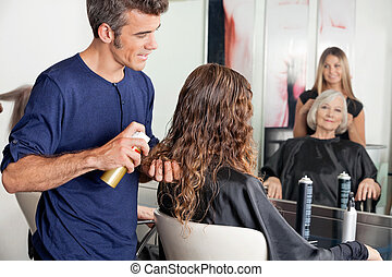 Hairstylists Setting Up Clients Hair - Hairstylists setting...
