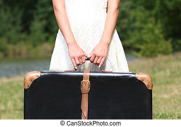 hands of a woman with a suitcase - hands of a young woman...