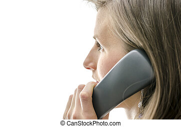 Side view of female call center employee talking on a phone...