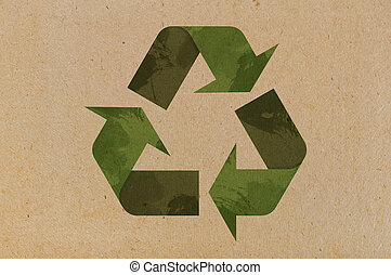 Recycle icon on cardboard  background closeup