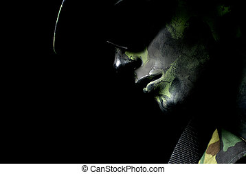 Dark soldier portrait with camouflage