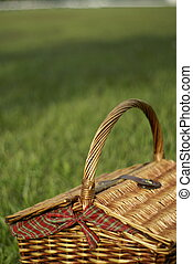 Picnic hamper basket in field