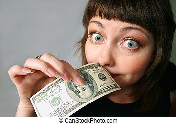 Money has no smell - Woman with hand of money, looking...