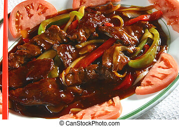 spicy beef dish - A dish of spicy beef and vegetables.