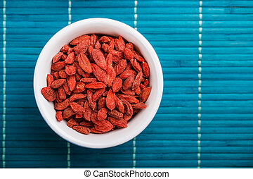 Goji berries - Dried Tibetan goji berries in ceramic bowl