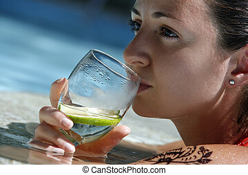Glass of water - The beautiful girl with a glass of water in...