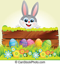 cute rabbit in with easter eggs