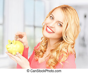woman with piggy bank and cash money - picture of lovely...
