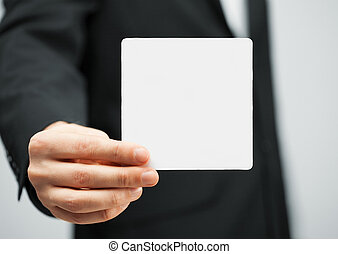 man in suit holding blank card - picture of man in suit...