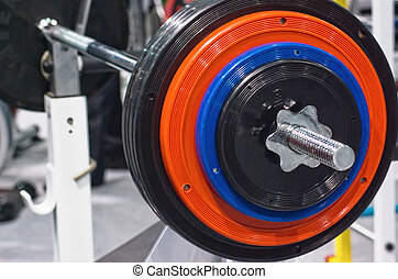 barbell - Kettlebells at gym with lifting bar weights...