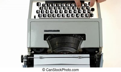 fingers on typing machine - fingers on vintage typing...