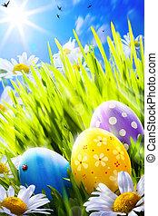 Art easter eggs in flowers