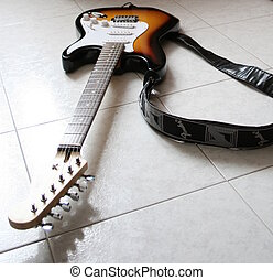Isolated guitar - An electric guitar on the floor