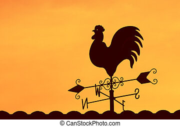 Weather Vane on the roof  - Weather Vane in Colorful Sky