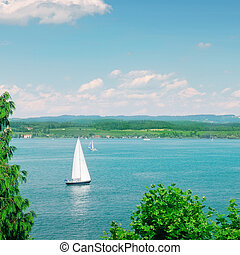 Sailboat on a beautiful lake - Sailboat on a beautiful lake...