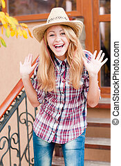 Happy young girl in cowboys hat