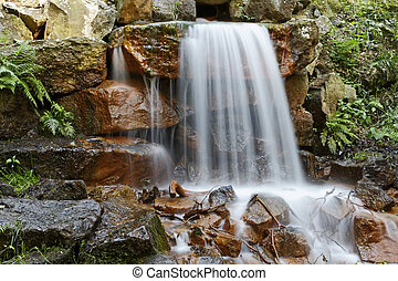Small waterfall in Germany - Small waterfall in a park in...