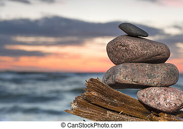 Baltic sea in Poland. - Sunset with pile of stones. Baltic...