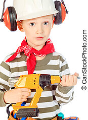 professional - Little boy in a helmet plays in the builder...
